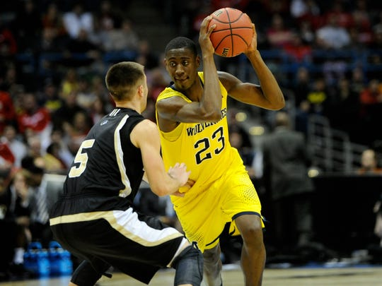 Michigan Wolverines guard Caris LeVert (23)