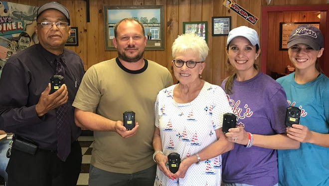 """Several Opelousas business owners have come together to help the Marshals Office by purchasing body cameras for tdhe deputy marshals. With the current affairs that law enforcement is forced to deal with on daily basis, we must have a clear path to accountability. """"It is a known fact that people behave differently when they know they are being watched, use of force incidents and complaints can easily be resolved by pressing play"""", Mouton said. Budget cuts hinder our ability to be efficient but with their amazing support, we can continue to progress in the right direction, the new cameras will replace outdated equipment. Pictured: Marshal Paul Mouton, Derrick Comeaux, Elaine Cormier, Laurie McDaniel, Alexis DeVillier, Robbie DeVillier (not pictured)"""