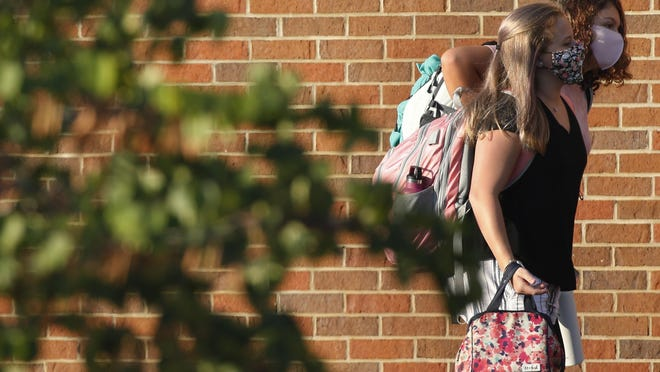 Oconee County Middle School students head for class on the first day of school Aug.5 in Watkinsville.