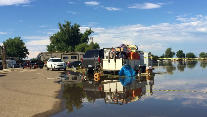 The Kings River overflowed and flooded homes at Riverland Resort in Kingsburg on Sunday.