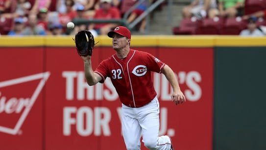 Reds right fielder Jay Bruce catches a fly ball off