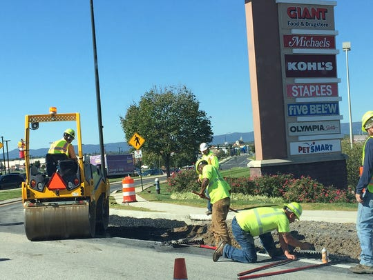 Work is underway to extend the right turn lane on Walker