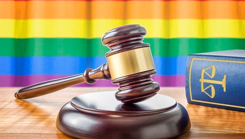 Gavel and a law book - Rainbow flag