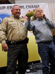 Brown County Sheriff Vance Hill pats Rex Tackett's
