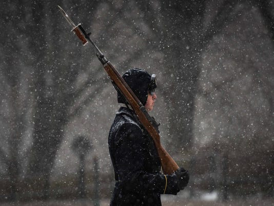 "A member of ""The Old Guard"" stays with the Tomb of the Unknown Soldier during a snow storm."