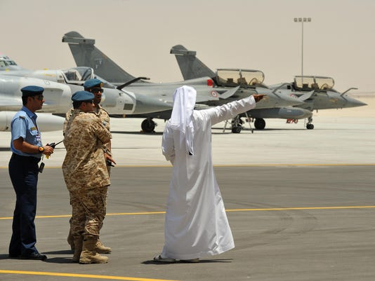 Emirati military personnel stand near tw