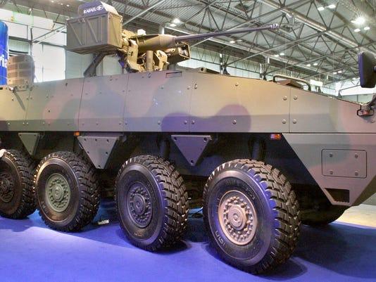A customer checks the Finnish Patria AMV