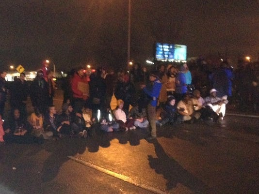 Protesters close down Interstate 94 in Minneapolis Monday night.