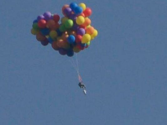 article this arrested alberta flying lawn chair attached balloons