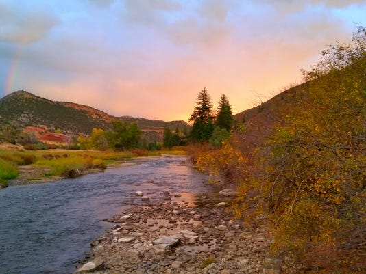 635798294728639014-Rainbow-at-sunset-along-the-eagle-river---Amy-Estes
