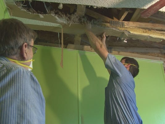 Crews fix leaky roofs flooded basements after heavy rains Roof leaks when it rains hard