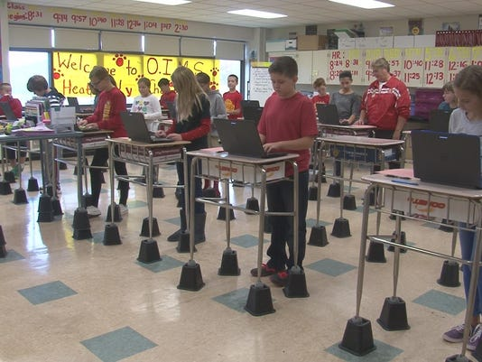 olean teacher makes desks so students can stand tall