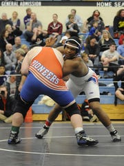 Zanesville's Leo Crosby wrestles an opponent in the 220 weight class during the Division I District wrestling tournament Saturday at Hilliard Darby High School.