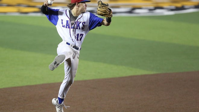 Hays Larks' shortstop Cam Pherson (17) gets the ball throws to first base, making the out against the Hutchinson Monarchs Friday evening at Eck Stadium during the NBC World Series. The Monarchs defeated the Larks 11-3.