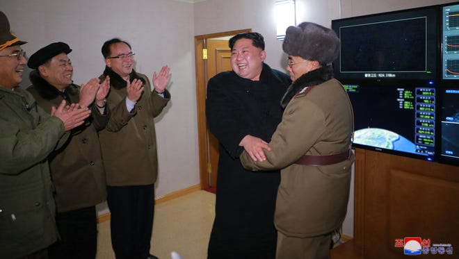This photo was released by the North Korean Central News Agency on Nov. 30, 2017 of North Korean leader Kim Jong Un giving an order to test-fire the newly developed inter-continental ballistic rocket Hwasong-15 on at an undisclosed location in North Korea.