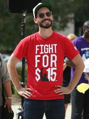 "Matthew Camp, with ""Fight for 15,"" an advocacy group for a living wage, as shown listening to speakers during the Moral Mondays rally at the Indiana Statehouse on Sept. 20, 2014."