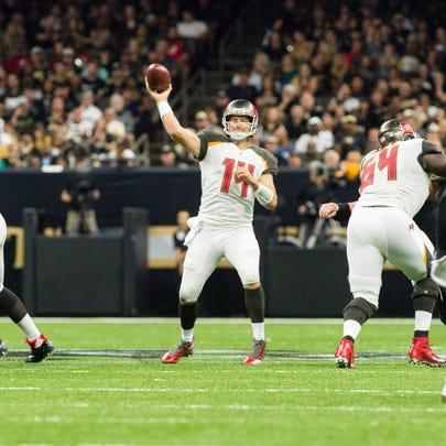 Buccaneers quarterback Ryan Fitzpatrick throws a pass