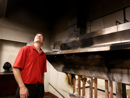 Kevin Boyles, co-owner of the Sassy Onion Grill, looks at the damage from a kitchen fire that has closed the restaurant for a couple of months. Photo taken on Tuesday, Nov. 17, 2015, in Salem, Ore.