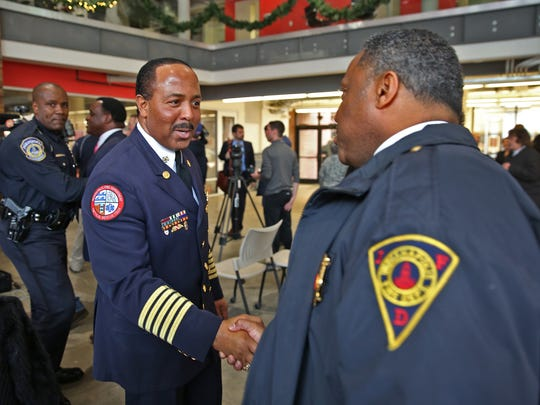 Indianapolis Fire Department Chief Ernest Malone, left, is congratulated after a news conference where Mayor-elect Joe Hogsett announced his plan to retain Malone as fire chief on Tuesday, December 8, 2015.