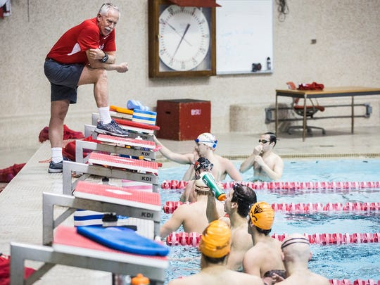 Ball State men's swimming coach Bob Thomas chats with swimmers at Lewellen Pool during practice.