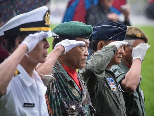 Color guard members salute during the Vietnamese Community