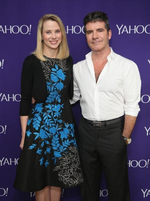 President and CEO of Yahoo! Marissa Mayer and Simon Cowell attend the 2015 Yahoo Digital Content NewFronts at Lincoln Center's Avery Fisher Hall.