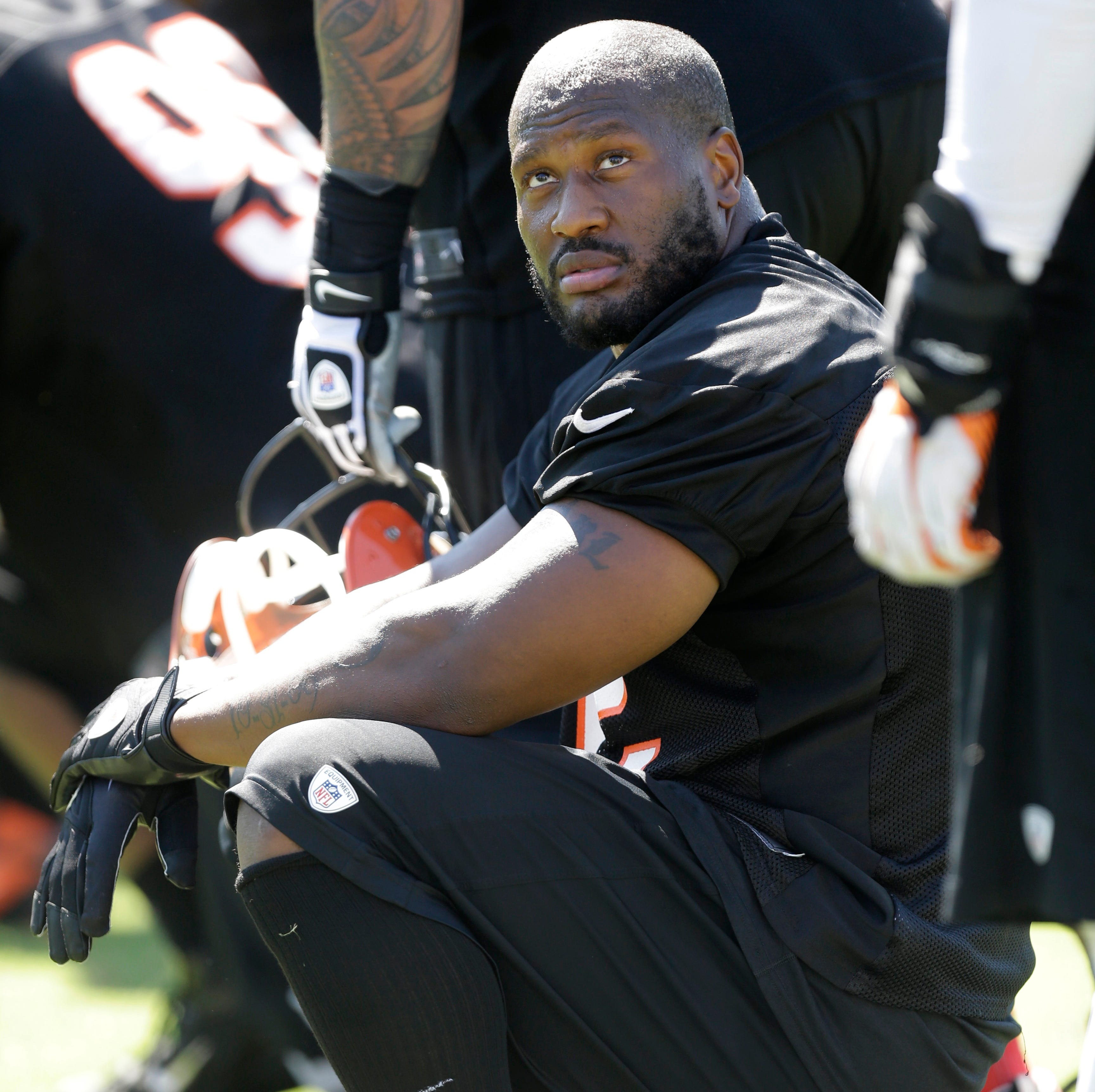 Cincinnati Bengals linebacker James Harrison takes a break during practice at the NFL football team's training camp, Thursday, July 25, 2013, in Cincinnati.