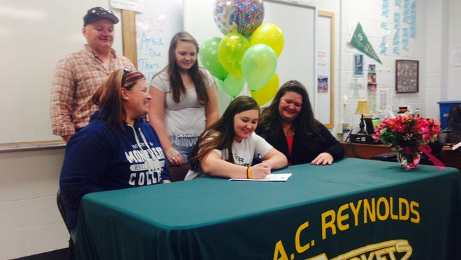 Reynolds senior Josie Harris signed to play college softball for Montreat on Monday.
