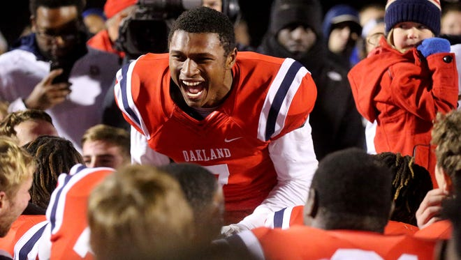 Oakland's JaCoby Stevens (7) celebrates with the team after the win over Maryville on Friday, Nov. 25, 2016, during the fourth round of the TSSAA Football play-offs. Final score 23-7.