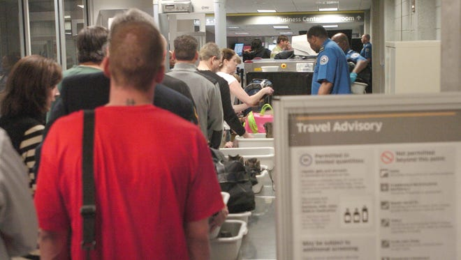 In this 2011 file photo, travelers were delayed while security personnel hand-checked their carry-on bags at the Jackson-Medgar Wiley Evers International Airport. Airline passengers experienced delays at security checkpoints because a baggage scanner failed at the terminal.