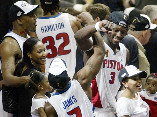Pistons forward Corliss Williamson, top left, guard Mike James and guard Ben Walllace celebrate their NBA championship over the Los Angeles Lakers at the Palace of Auburn Hillson June 15, 2004.