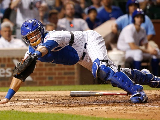 FILE - In this Monday, Aug. 14, 2017 file photo, Chicago Cubs catcher Alex Avila snags a wide throw from second baseman Tommy La Stella during the eighth inning of a baseball game against the Cincinnati Reds in Chicago. The Arizona Diamondbacks have finalized an $8.25 million, two-year contract with free agent catcher Alex Avila, Wednesday, Jan. 31, 2018. (AP Photo/Charles Rex Arbogast, File)