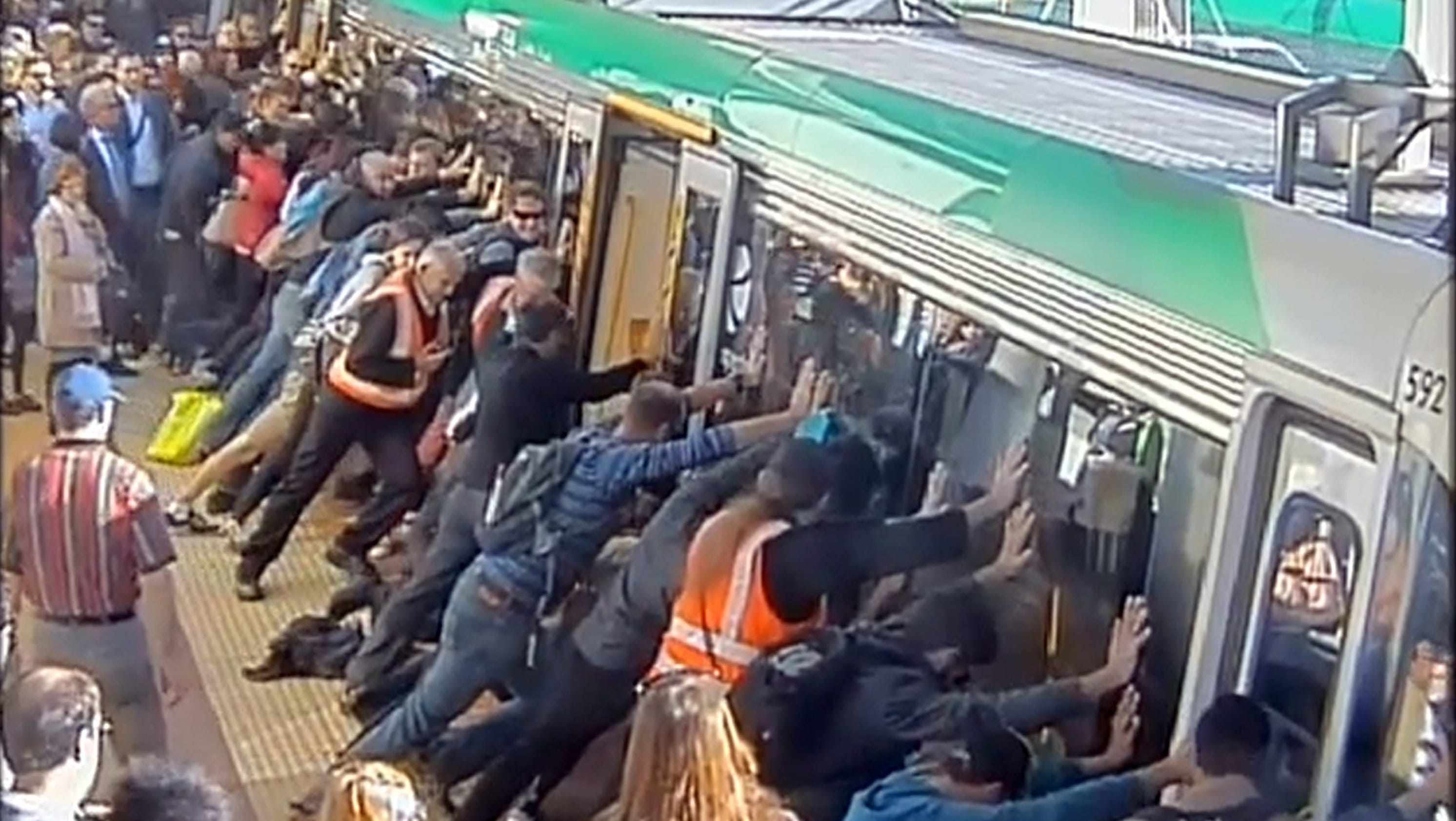 Commuters Tip Train Cars To Help Trapped Man