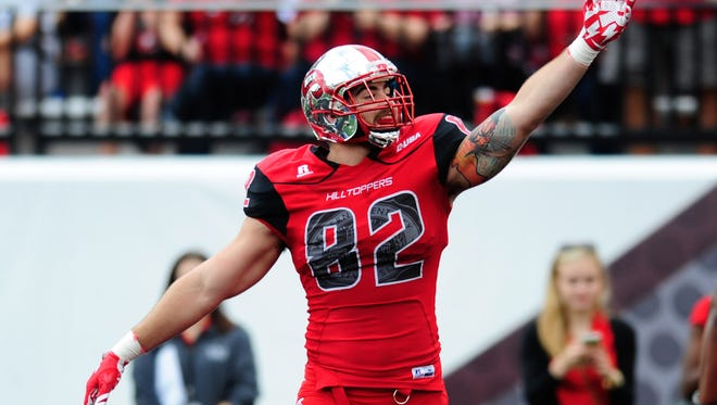 Oct 10, 2015; Bowling Green, KY, USA; Western Kentucky Hilltoppers tight end Tyler Higbee (82) celebrates after scoring a touchdown during the first half against Middle Tennessee Blue Raiders at Houchens Industries-L.T. Smith Stadium. Mandatory Credit: Joshua Lindsey-USA TODAY Sports