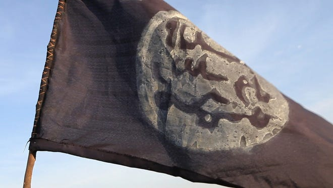 A Boko Haram flag flutters from an abandoned command post in Gamboru deserted after Chadian troops chased them from the border town on February 4, 2015. Nigerian Boko Haram fighters went on the rampage in the Cameroonian border town of Fotokol, massacring dozens of civilians and torching a mosque before being repelled by regional forces. AFP PHOTO/STEPHANE YASSTEPHANE YAS/AFP/Getty Images ORIG FILE ID: 537442653
