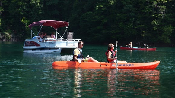 Pontoon boaters and kayakers enjoy Fontana Lake in this file photo.