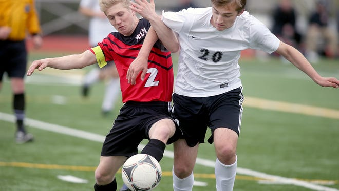 Central Kitsap soccer player Drew Diefendorf, right, chases the ball against Yelm's Gavin Stewart at Silverdale Stadium on Tuesday.