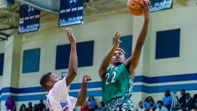 Easley's Deandre Byrd (22) makes a layup on a fast break during the Green Wave's 55-47 win at J.L. Mann Friday night