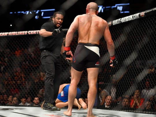 Eddie Alvarez (right) is warned by referee Herb Dean