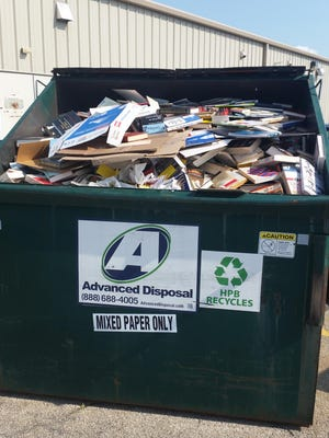 The image Jeremy Neumann shared on Facebook of a Half Price Books recycling Dumpster in Grand Chute was shared more than 1,100 times.