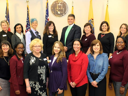 "Members of the Leadership Somerset Class of 2017 pose for a graduation photo in the Freeholders' Meeting Room in Somerville. From left: (bottom row) Sushmita Pradhan of Bridgewater, Fabiola Rodriguez of Green Brook, Terrene Collins of Franklin, Rebecca Crawford of Middlesex, Anne Buckley-Johnson of Bridgewater, Carrie Springer of Califon, Alicia Berkowitz of Bedminster, Lisa Patterson of North Plainfield and Jean Trujillo of Hillsborough; (top row) Aimee Lam of Bridgewater, Cynthia Starke-Meanwell of Bernardsville, Nandini Dutta of Hillsborough, Selwa Shamy of Somerville, Wendy Weinstein Hickey of Bedminster, Joseph Esposito of Basking Ridge, Tanya Kaplan of Franklin, Katy Lido of High Bridge and Wendy Ewen of Branchburg. Not shown are Krista Hartrum of Hampton, Ken Kaplan of Bridgewater and Richard ""Bick"" Treut of Somerville."