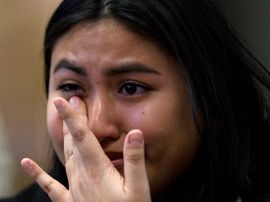 Laisha Calalpa, 17 a senior at Passaic High School wipes away at tear after participating in the National School Walkout in support of a student lead protest against gun violence following the shooting at Parkland High School in Florida. The walkout on Wednesday, March 14, 2018 marked the one month anniversary of the shooting in Parkland.