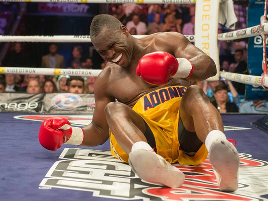 Adonis Stevenson grimaces after going down in the 9th round of his fight with Andrzej Fonfara in a WBC light heavyweight title bout in Montreal on Saturday, May 24, 2014. Stevenson successfully defended his World Boxing Council light-heavyweight title Saturday night, unanimously outpointing Poland's Andrej Fonfara.  (AP Photo/The Canadian Press, Peter McCabe)