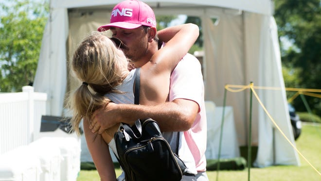 Stephan Jaeger celebrates with fianceé Shelby Garren after winning the Knoxville Open on Sunday.