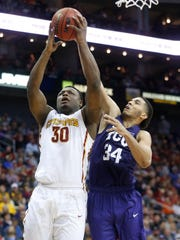 Iowa State guard Deonte Burton (30) goes for the shot as TCU guard Kenrich Williams (34) defends Friday, March 10, 2017 during the semifinals of the Big 12 Men's Basketball Championship in Kansas City.