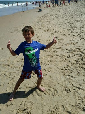 Nickolas Mohl, 7, spends the summers at the beach with his grandmother, Shirl Mohl.