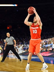 Syracuse Orange guard Trevor Cooney (10) shoots the