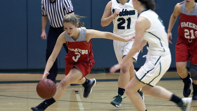 From left, Somers' Gabrielle Rosenzweig (3) steals the ball in front of Yorktown's Kelly Donnellan (21) during a girls basketball game at Yorkktown High School Jan. 17, 2015. Somers won the game 49-43.