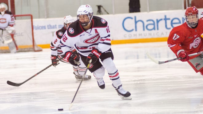 St. Cloud State University's Molly Illikainen (12) skates with the puck against Ohio State at the Herb Brooks National Hockey Center. Illikainen leads the Huskies in goals (12) and points (21). St. Cloud State is riding a program-best six-game winning streak into this weekend's WCHA series at Minnesota-Duluth.