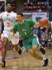 Novi Wildcat Trendon Hankerson (1) drives to the basket,